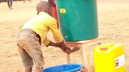 Washing hands at a water tank to combat the growing number of COVID-19 cases in Burundi_War Child