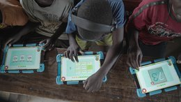 Children in school learning on tablets in Uganda with War Child's Can't Wait to Learn