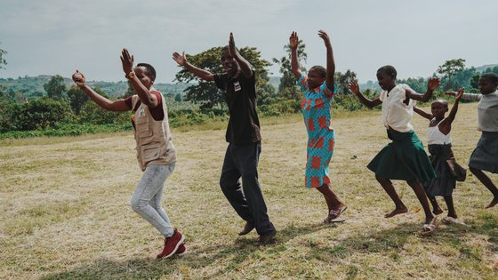 Group of Ugandans dancing in line - War Child projects TeamUp