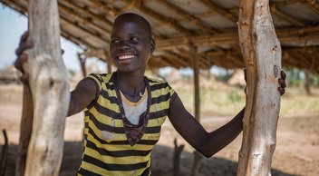 South Sudan girl outside smiling