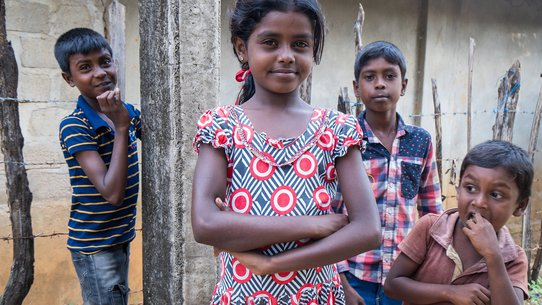 Girl with friends in Sri Lanka - War Child